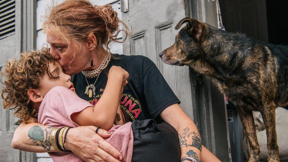 A woman comforts her grandson as the storm nears New Orleans