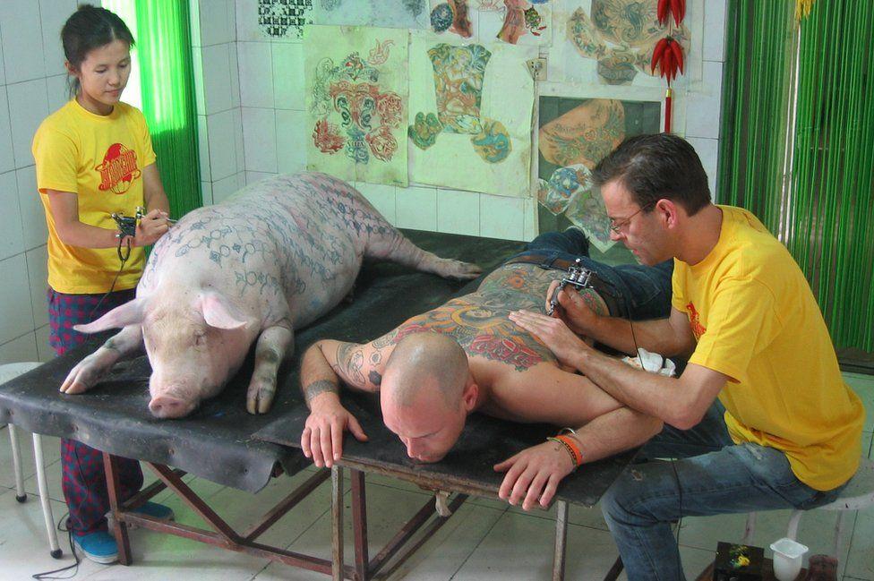 Tim Steiner being tattooed by Wim Delvoye