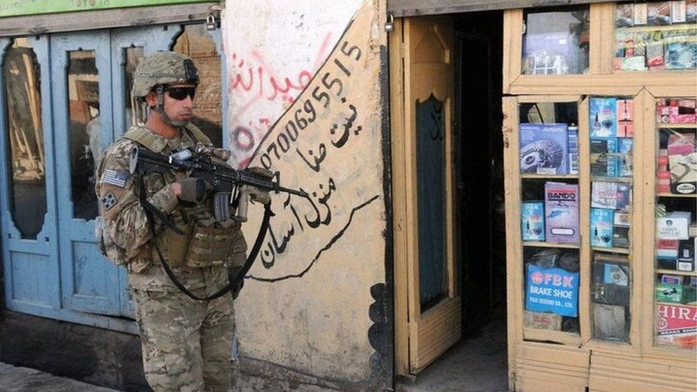A US soldier patrols the streets of Asadabad, Afghanistan
