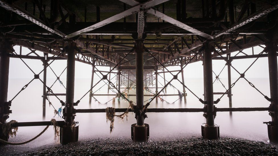 A grey and murky morning underneath Worthing Pier