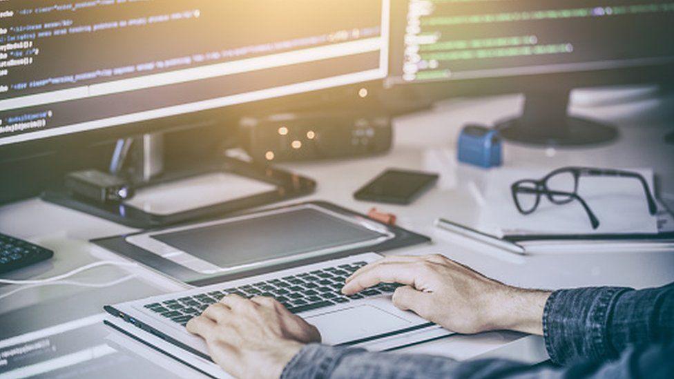 Man working at a computer screen