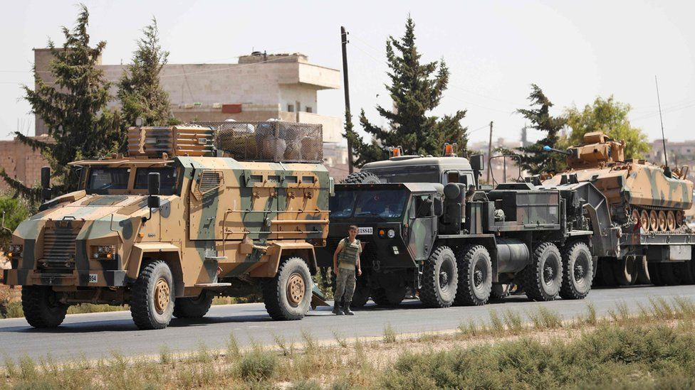 Turkish military vehicles seen in a convoy near the Syrian town of Saraqeb, in Idlib province (29 August 2018)