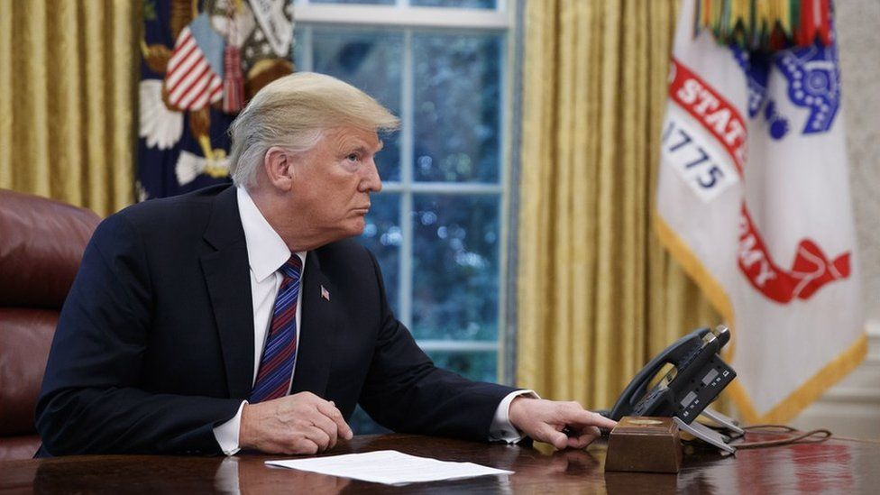 US President Donald J. Trump tries to connect the phone line with Mexican President Enrique Pena a Nieto to announce a trade deal in the Oval Office of the White House in Washington, DC, USA, 27 August 2018.
