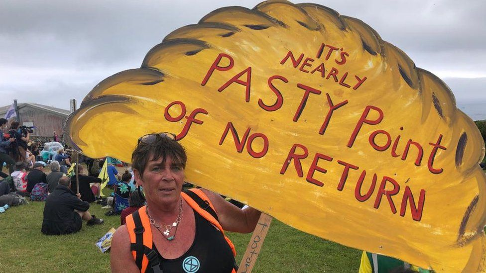 Protesters holding pasty sign saying 'it's nearly pasty the point of no return'