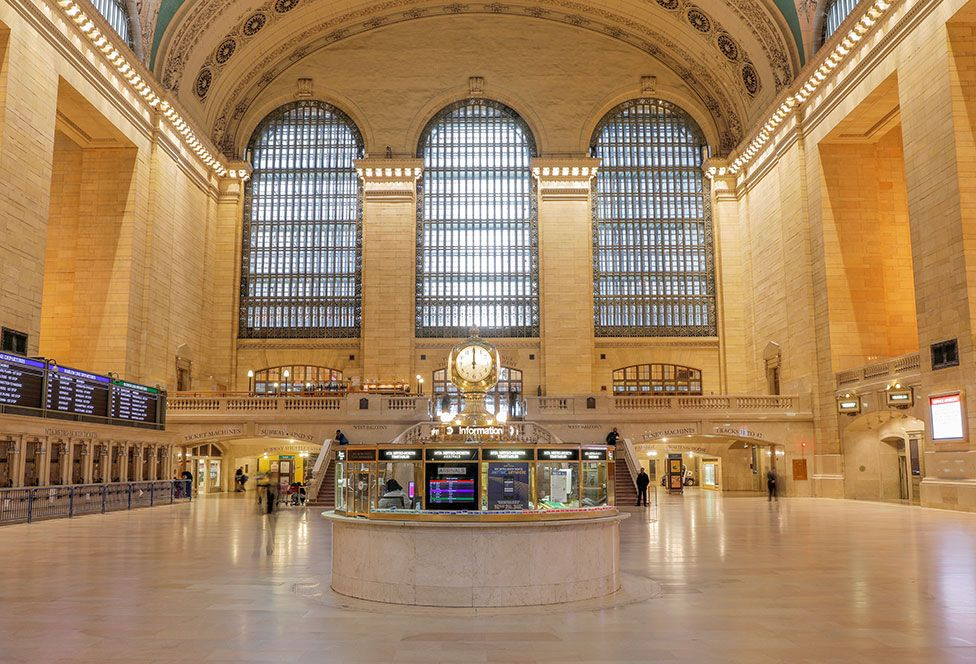 The clock strikes noon at the main concourse of the Grand Central Terminal in Manhattan in New York