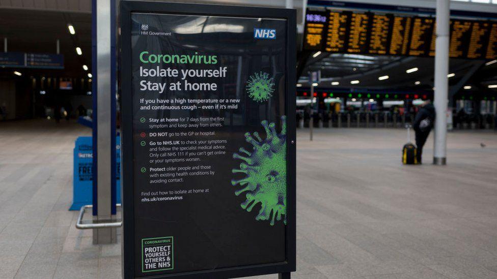 NHS coronavirus advice sign at London Bridge Station