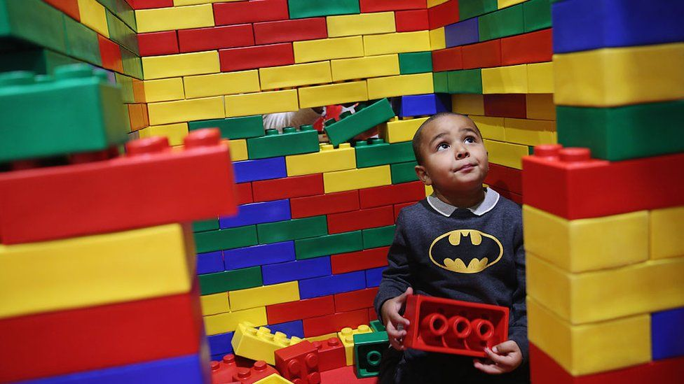 Boy plays with outsized Lego bricks