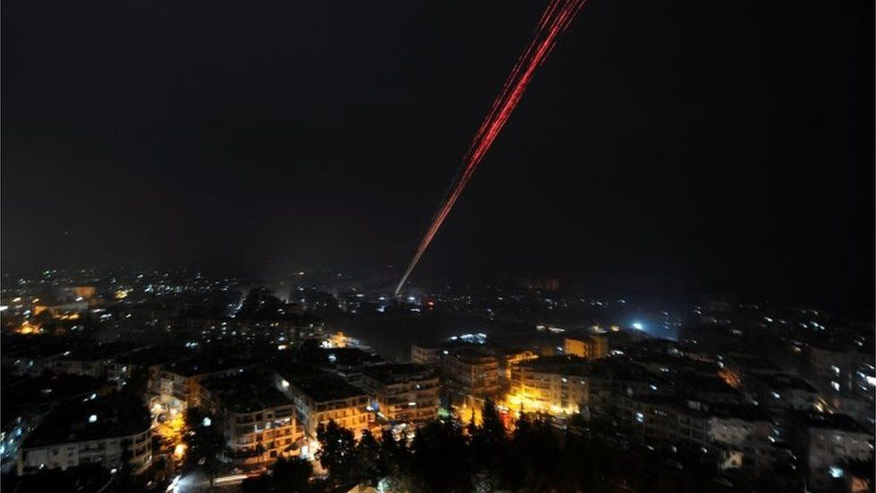 Syrian forces fire into sky as celebrating their victory against rebels in eastern Aleppo, Syria December 12,2016.