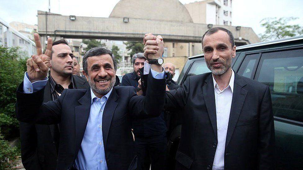Mahmoud Ahmadinejad holds hands with former vice-president, Hamid Baghaei (12 April 2017)