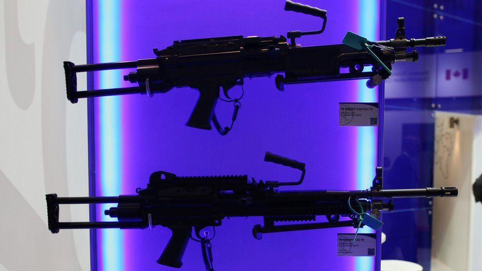 Belgian rifles are displayed at the Defence and Security Exhibition in London (10 Sept 2013)