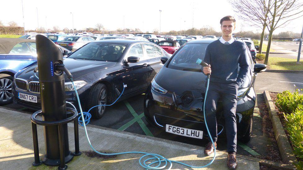 Matthew Thomason with his electric car