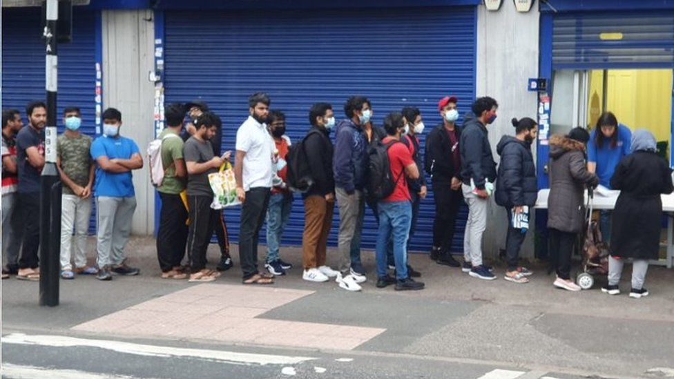 Students queueing outside the Newham Community Project food bank