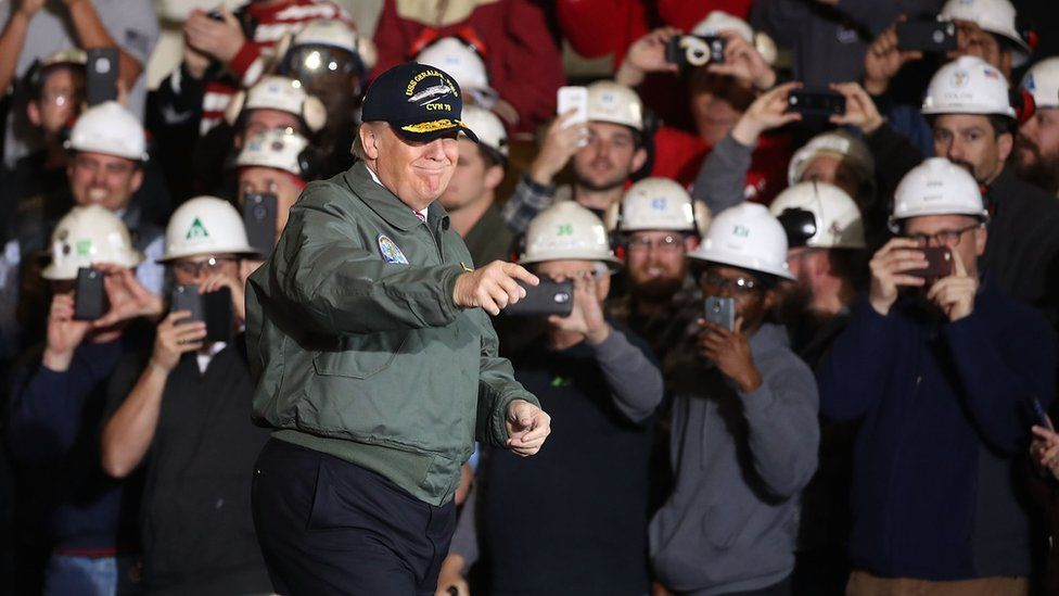 Donald Trump toured the Gerald R Ford aircraft carrier ahead of his remarks to members of the crew.