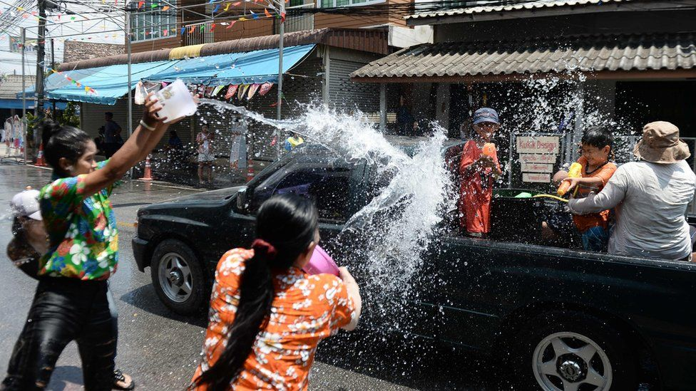 Revellers throw water on passing motorists