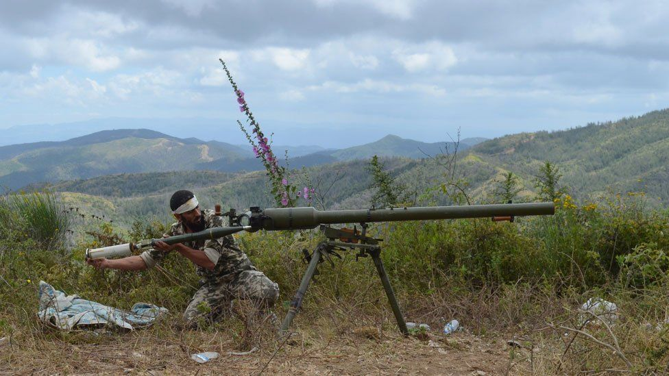 A rebel fighter loads an anti-tank cannon during fighting against pro-government forces on the outskirts of Syria's Mediterranean port city of Latakia, in 2014