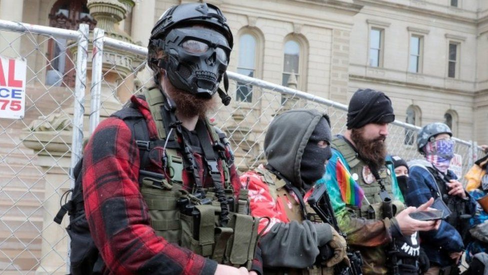 Members of the Boogaloo Bois protest against the election of President-elect Joe Biden, outside the Michigan State Capitol in Lansing, Michigan
