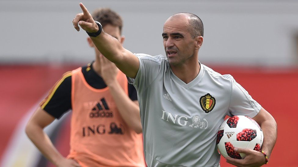 Belgium coach Roberto Martinez speaks to players during a training session at the Guchkovo Stadium in Dedovsk on 30 June 2018