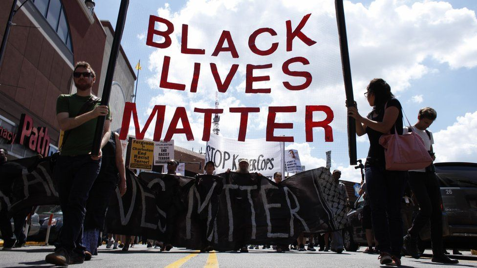 Protesters hold Black Lives Matter banner at Brooklyn protest