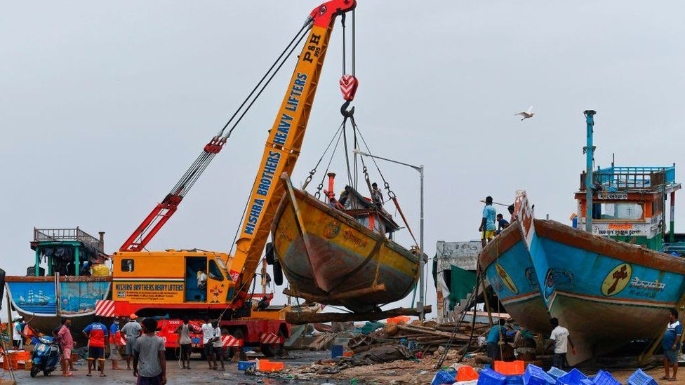 Mumbai fishing boats being cleared ahead of the cyclone