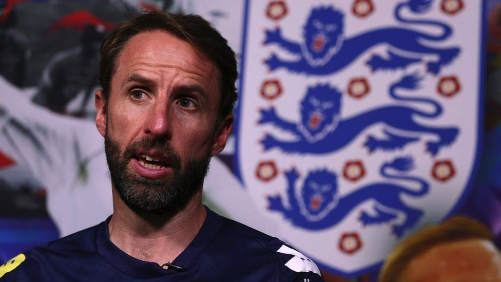 Gareth Southgate sitting in front of a Three Lions badge