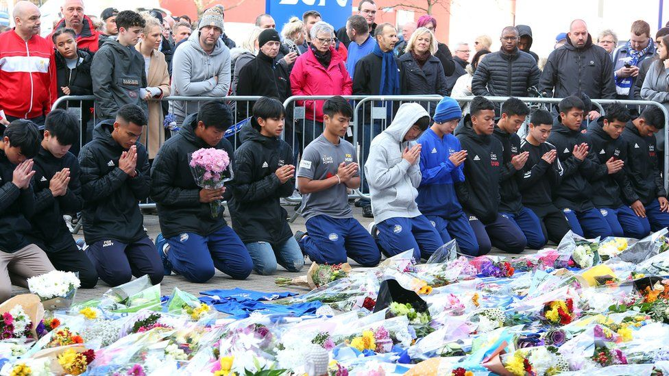 Fox Hunt Football Academy from Chaiyaphum in Thailand arrive to pay their respects outside the King Power stadium in Leicester