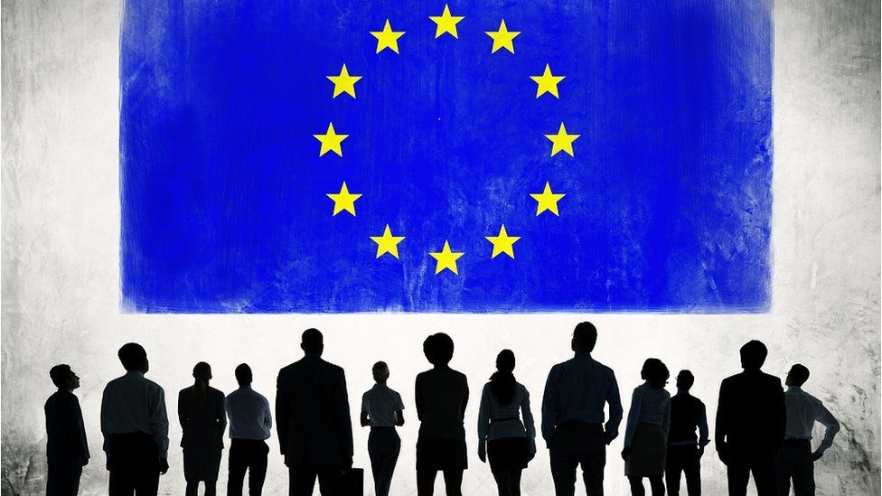 Silhouette of people with flag of European Union