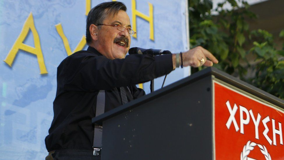Golden Dawn MP Christos Pappas addresses an election rally