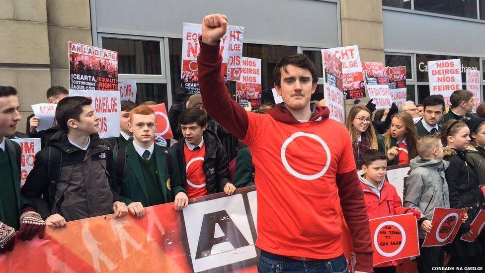 Irish language activists at a protest in Belfast against a decision to cut Irish language bursaries