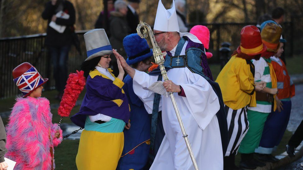 The Diddymen get high fives from the Bishop of Liverpool Paul Bayes