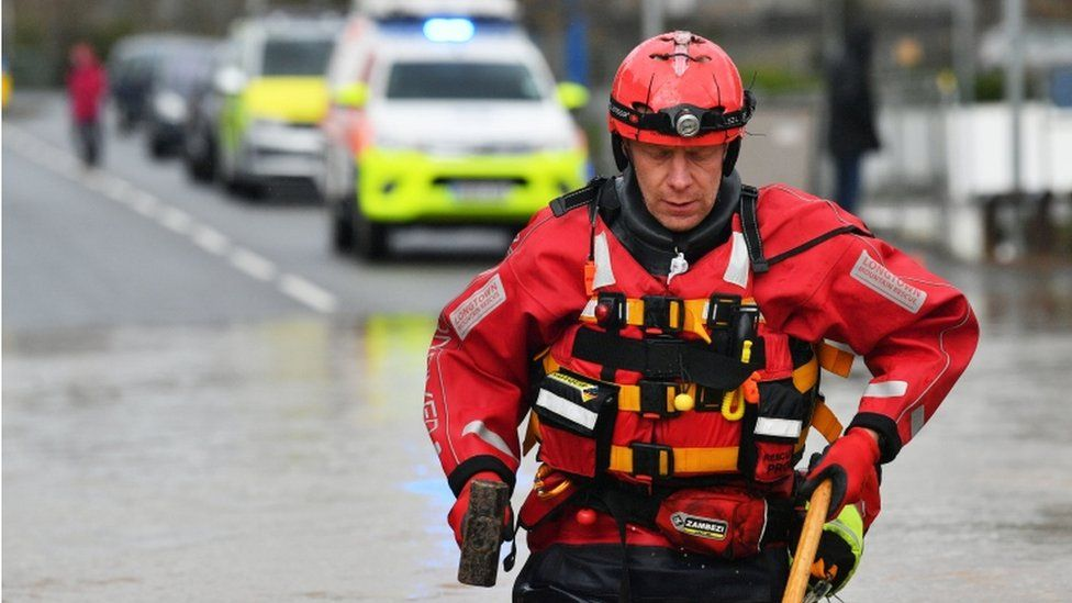 Mountain rescue workers have been working to save people from their homes