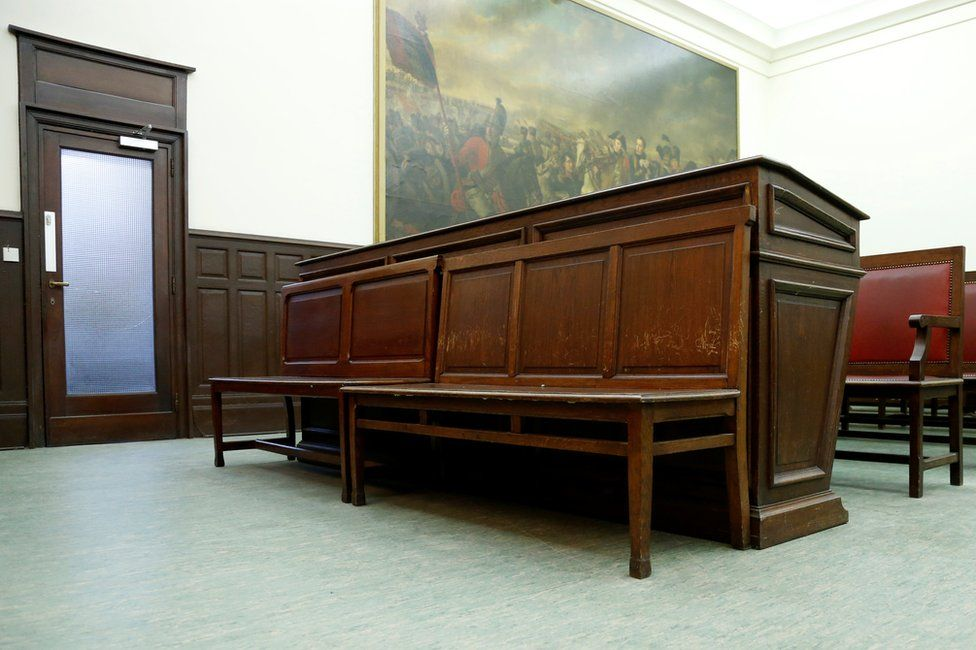 View of defendant's bench in a courtroom ahead of the trial of Salah Abdeslam, one of the suspects in the 2015 Islamic State attacks in Paris, at Brussels Palace of Justice, Belgium, 30 January