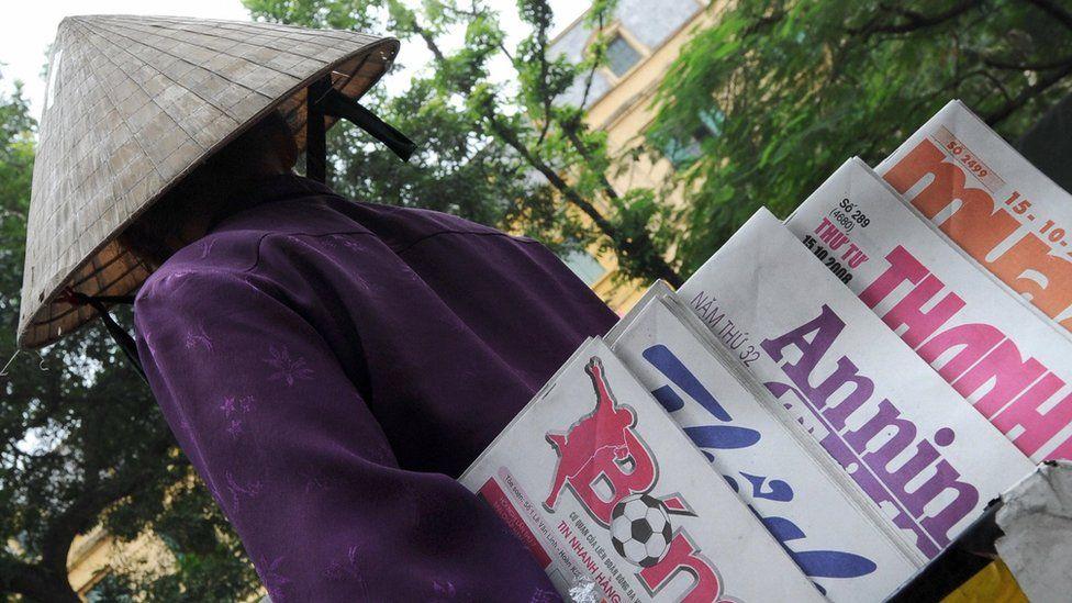 Newspaper vendor in Vietnam