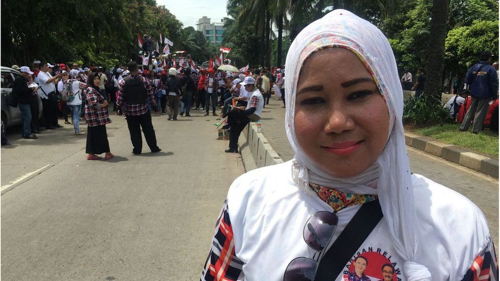 An Ahok supporter in a headscarf at a pro-Ahok rally
