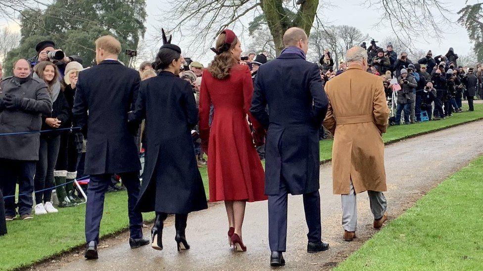 Royal family walking away from church