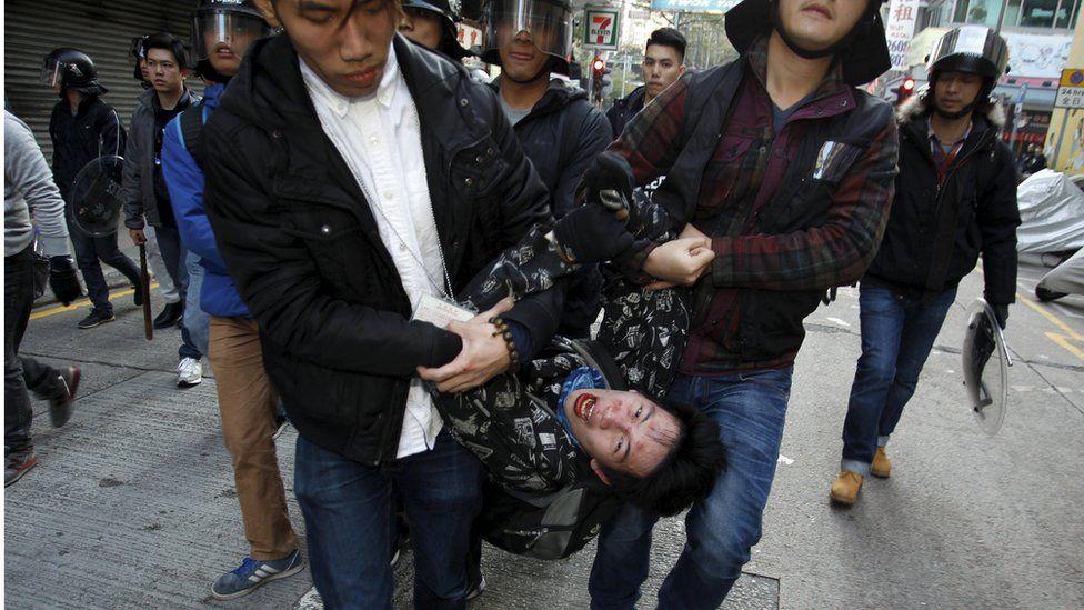 Plainclothes police arrest a shouting man