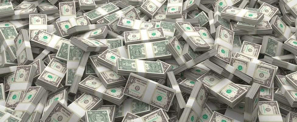 Image shows piles of US dollars