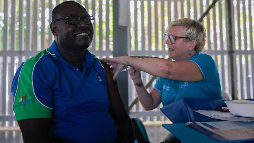 A man receives a jab in Boigu Island, in Australia's Torres Strait