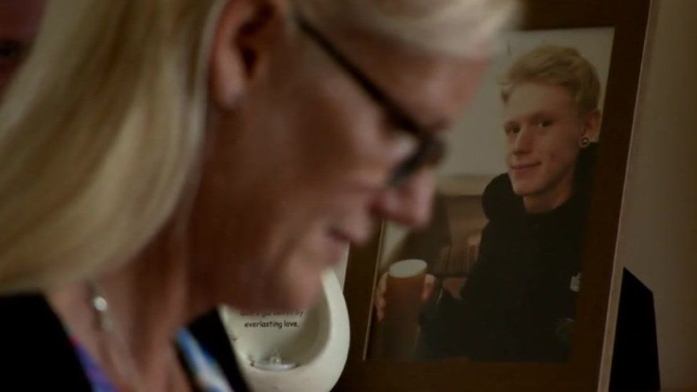 Michelle Fraser with a photo of her son, Robert