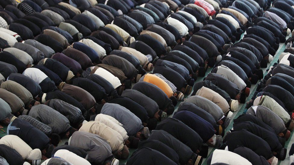 Muslims pray at a mosque in London