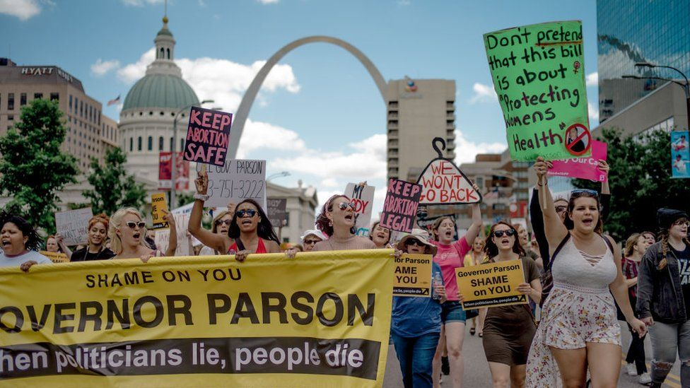 Attendees chant and march through downtown St Louis during a rally and march to protest the closure of the last abortion clinic in Missouri on 30 May, 2019 in St Louis, Missouri
