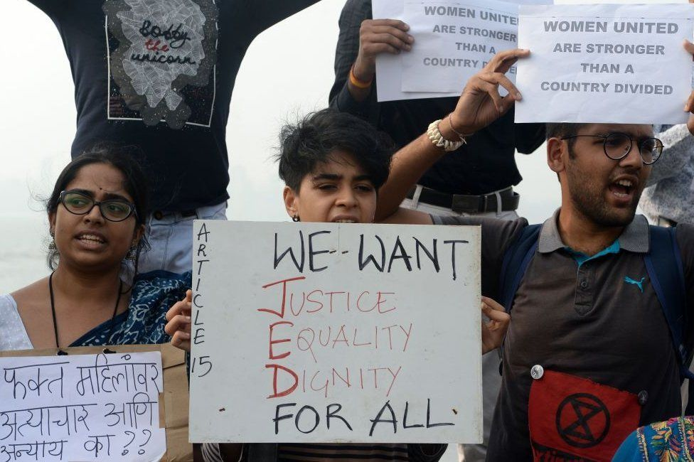 Activists and supporters hold placards and shout slogans to protest against the alleged rape and murder of a 27-year-old veterinary doctor in Hyderabad and other recent sexual assaults, in Mumbai on December 8, 2019.