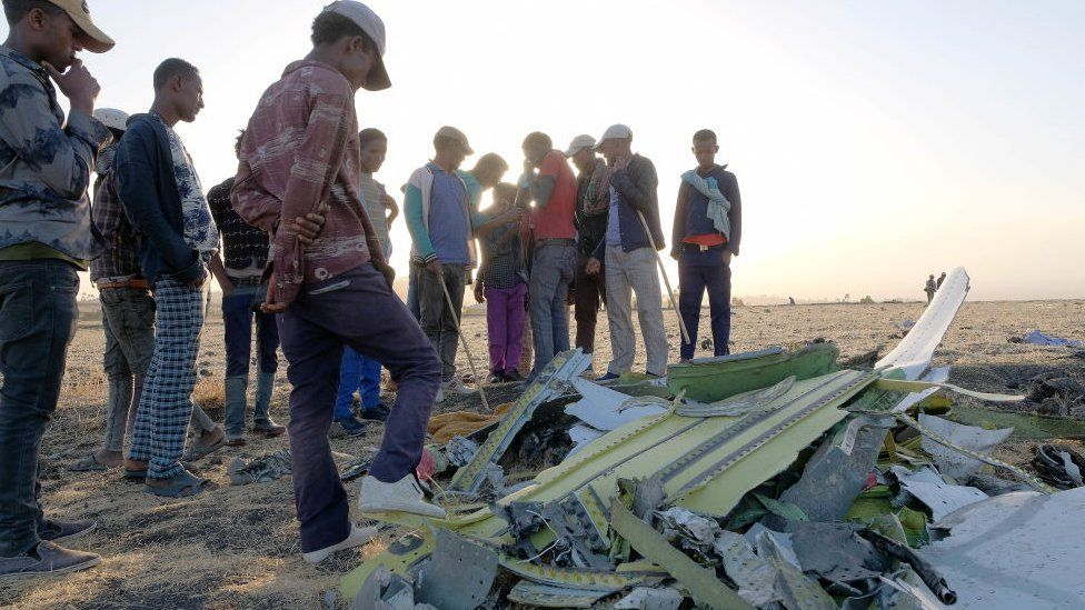 People gather at the Ethiopian Airline crash site