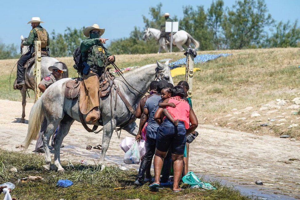 A US Border Patrol agent on horseback tries to stop Haitian migrants from entering an encampment on the banks of the Rio Grande near the Acuna Del Rio International Bridge in Del Rio, Texas, on 19 September 2021