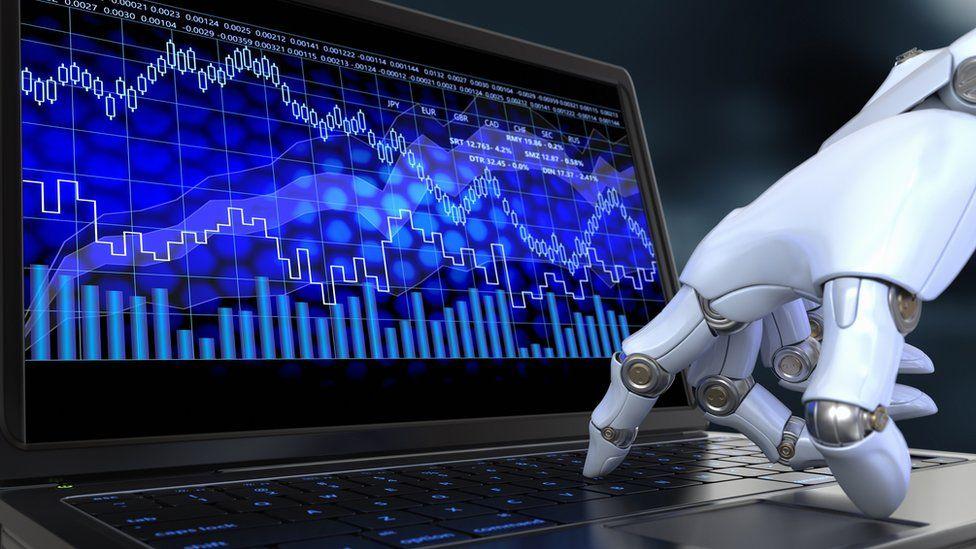 robot touching a computer screen