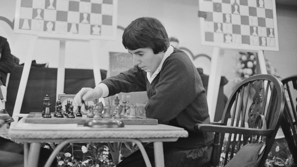 Nona Gaprindashvili plays a game of chess at the International Chess Congress in London on 30 December 1964