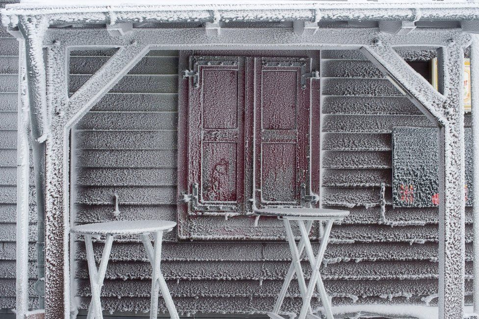 A building covered in frost