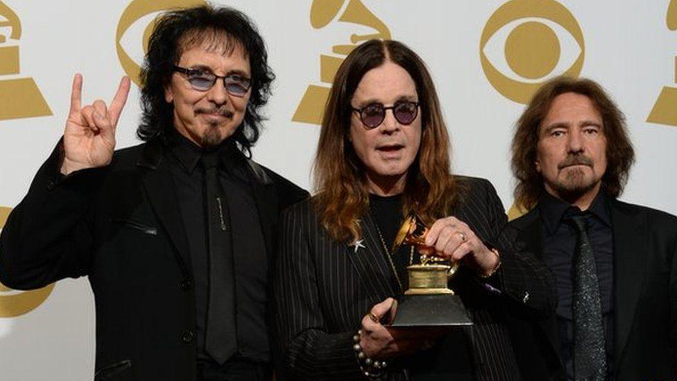 Tony Iommi with Ozzy Osbourne and Geezer Butler of Black Sabbath