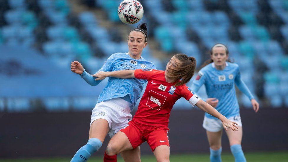 Lucy Bronze of Manchester City and Christie Murray of Birmingham City in action