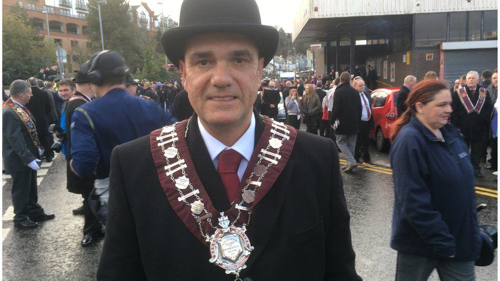 Graeme Stenhouse, the new Apprentice Boys governor, wearing a black hat and Apprentice Boys chain