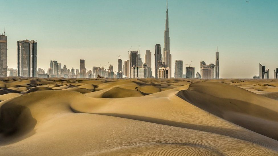 Dubai cityscape with desert in front